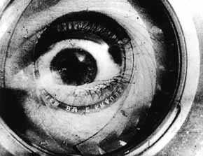 Double exposure of a camera lens and a human eye